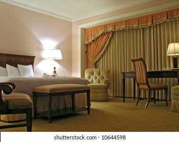 Bedroom with table chairs lamp and curtain