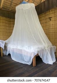 Bedroom in a wood bungalow. Vertical shot.