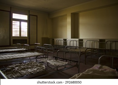 Beds in an abandoned old room in semi darkness