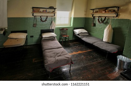 Beds and kit belonging to WW1 soldiers in a restored army barracks room