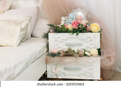 bedside table. the bedside table is decorated with flowers