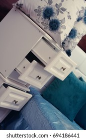 Bedside table with pillows on the background