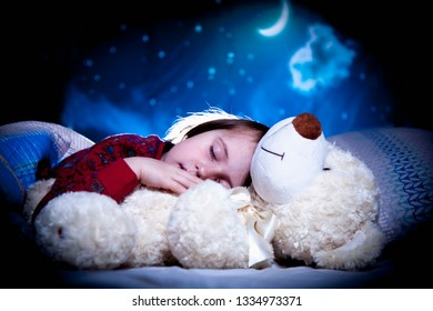 Bedtime. Happy dreams of a little girl. Child girl relaxing in bed. Sleep, health, happiness, childhood concept.