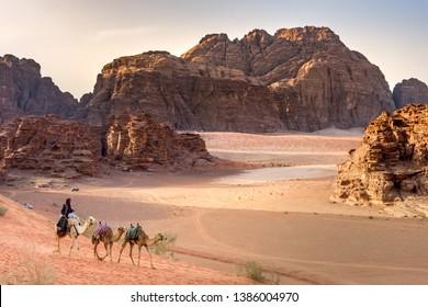 Beduin and camels in Wadi Rum desert in Jordan on April 28, 2019