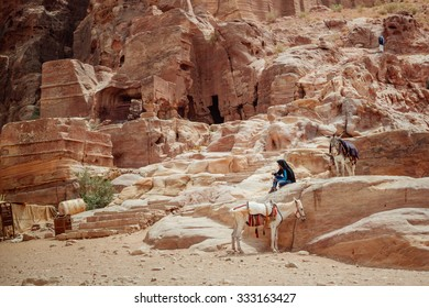 The beduin with donkey at the ancient site of Petra, Jordan