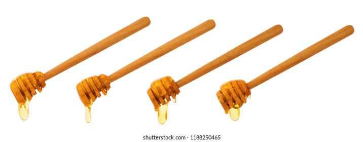 Bee honey drops and wooden sticks isolated on white background with clipping path. Healthy natural food ingredient. Apitherapy, alternative medicine.