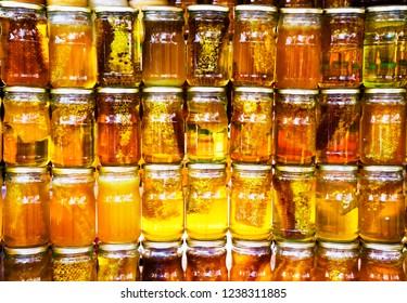 bee honey in jars on display in the market, healthy food