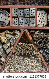 Bee and insect house made from natural materiels such as straw, wood, bark and fir cones.