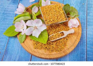 bee pollen on a blue wooden background