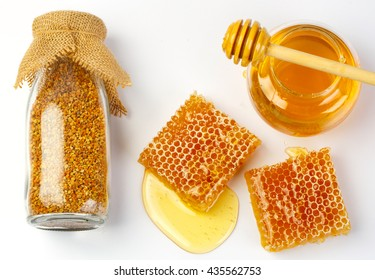 Bee products with honey in jar, sweet honeycomb, bee pollen isolated on white background, healthy products by organic natural ingredients concept