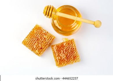 Bee products with honey in jar and sweet honeycomb isolated on white background, healthy products by organic natural ingredients concept