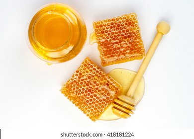 Bee products with honey and sweet honeycomb isolated on white background, healthy products by organic natural ingredients concept