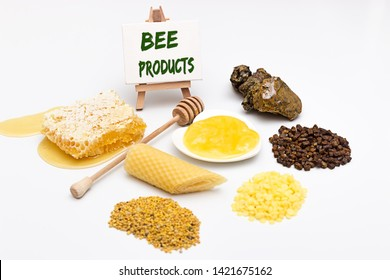 Bee products on a white background and an easel with the inscription bee products