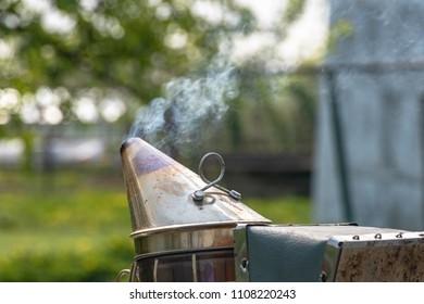 bee smoker with smoke