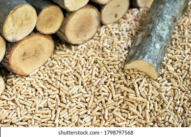 Beech wood and wooden pellets. Wooden materials and biomass.