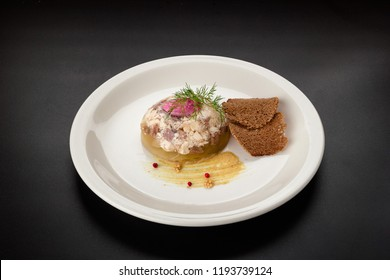 beef aspic with croutons on black background