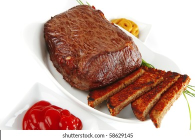 beef and bread on round white dish