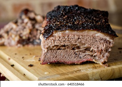 Beef Brisket Classic Texas Smoked BBQ Traditional Texas Smoke House Beef Brisket barbecue. Rubbed with spiced & slow smoked in a classic Texas smoke house over mesquite wood chips in smokehouse