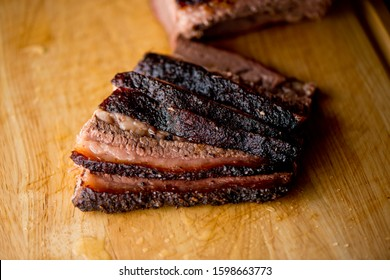 Beef Brisket. Traditional Texas Smoke House barbecue. Rubbed with spiced & slow smoked in a classic Texas smoke house over mesquite wood chips in traditional classic bbq method. Chopped Beef Brisket.