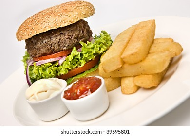 Beef Burger in bun with chips and relish