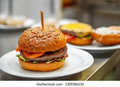 Beef burger with cheese, vegetables and sauce