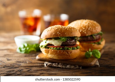 Beef burger with mozzarella cheese, tomato and pesto sauce