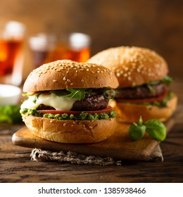 Beef burger with mozzarella cheese, tomato and pesto sauce