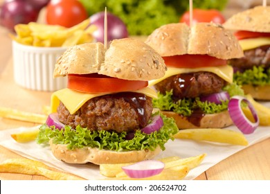 Beef burgers with cheese and vegetables.Selective e focus on the front burger