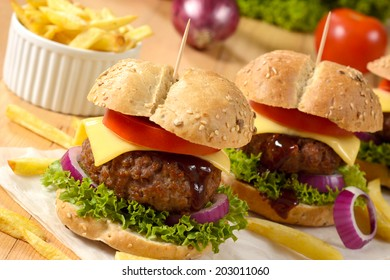 Beef burgers with cheese and vegetables.Selective focus on the front burger