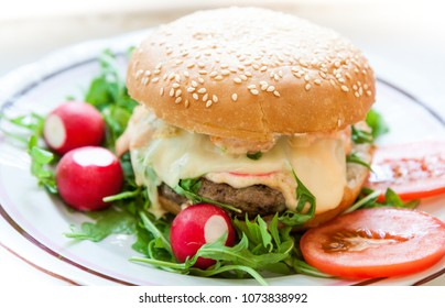 Beef cheeseburger on plate