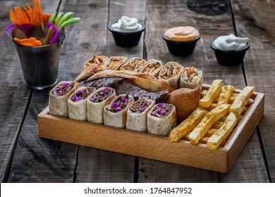 Beef and chicken shawarma sandwich plate with fries and kobeba