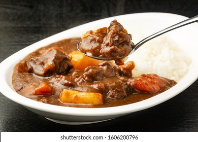 Beef curry served on a plate