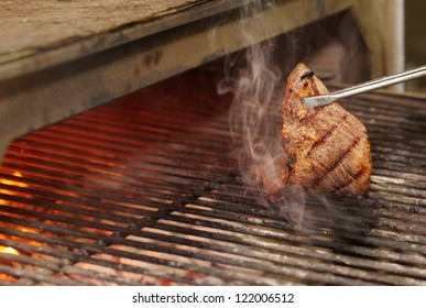 Beef diaphragm - skirt steak - being fried on grill