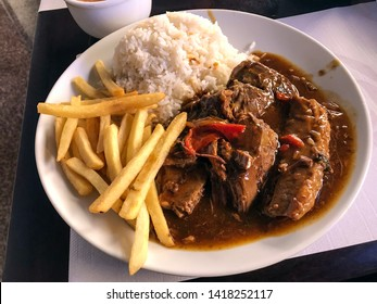 Beef filet mignon with wood sauce with potato chips and rice