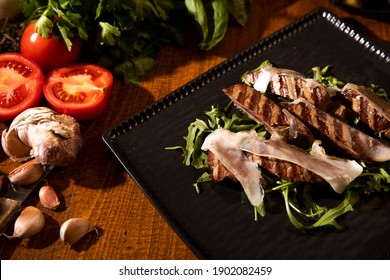 Beef fillet flambe on wooden table