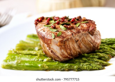 Beef fillet with pink pepper and asparagus.