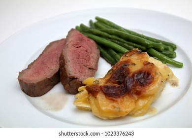 beef fillet with potato gratin and beans