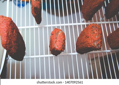 beef flaccid on a string on a beige background
