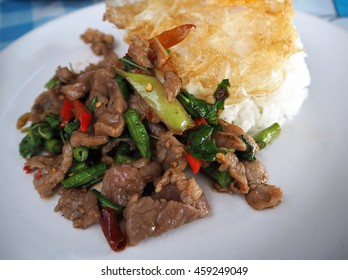 """Beef fried with Basil and Chili and Egg.Thai food Name is """"Pad Kra Pao"""""""