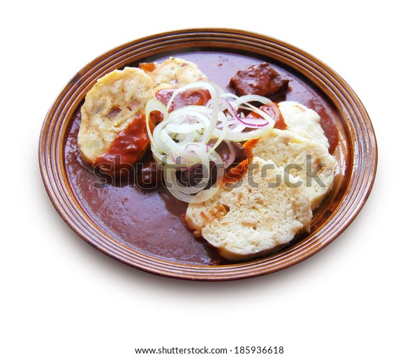 Beef goulash with gravy and bread and potato dumplings, isolated on white background with clipping path