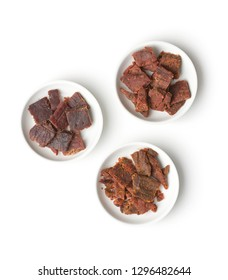 Beef jerky pieces isolated on white background. Marinated dried meat.