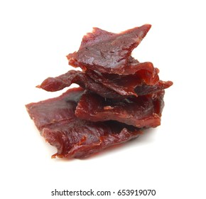 Beef jerky pieces on white background