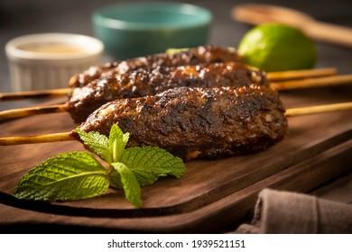 Beef kafta on the wooden board. Kafta, Traditional Arabic cuisine.