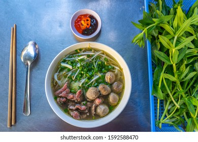 Beef meat balls noodle soup served with vegetables- Vietnamese Pho