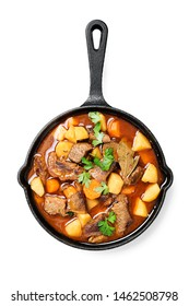 Beef meat  stewed with potatoes, carrots and spices (hungarian goulash). isolated on white background.