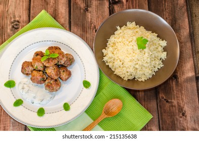 Beef meatballs with cilantro, garlic, couscous and mint dip
