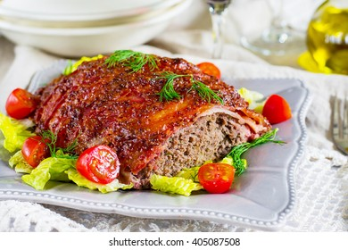 Beef meatloaf with bacon and mustard and ketchup crust. Selective focus