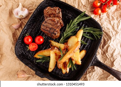 Beef Medallion Grilled Country Potato Flat Lay on Rustic Black Pan Serving for Delicious Recipe. Pork Fillet Fried on Skillet for Dinner with Rosemary, Garlic and Salt. Grill Juicy Meat Top Down View
