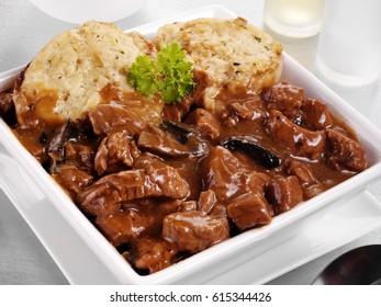 BEEF AND MUSHROOM CASSEROLE WITH DUMPLINGS