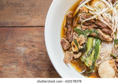 beef noodle soup,beef noodle Traditional on a wooden background